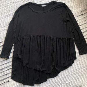 Black asymmetrical swing top